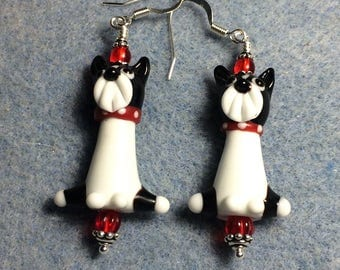 Black, white and red lampwork Boston terrier dog bead dangle earrings adorned with red Czech glass beads.