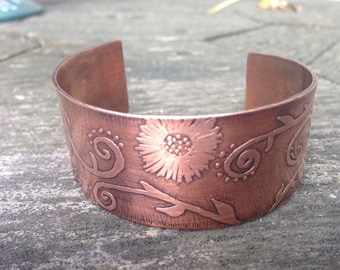 Handcrafted etched copper cuff with floral design