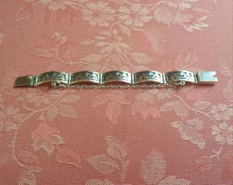 sterling silver story teller bracelet by artist A J Boyd