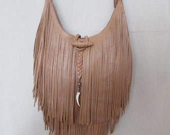 Cross body leather bag with double fringe