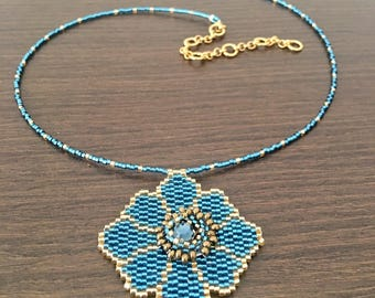 Small necklace in turquoise and gold flower with Rhinestone Heart