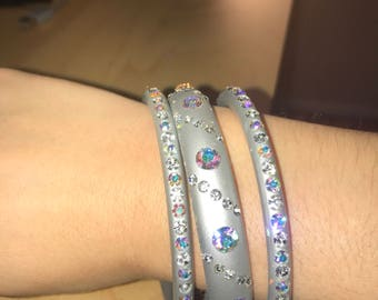 Silver/gray vintage bangle bracelets with rhinestones.