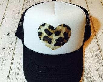Leopard print heart women's trucker hat. SnapBack adjustable, verify your size in description