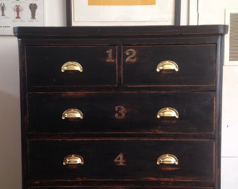 A Victorian ebonised chest of drawers, with hand painted type, Haberdashery.