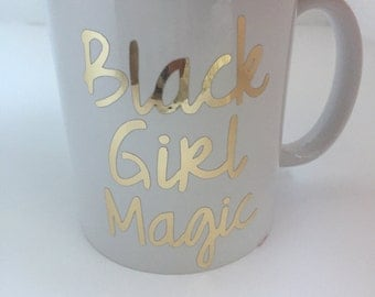 Metallic Gold Black Girl Magic white ceramic mug.