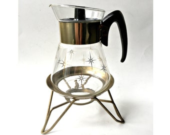 Corning Coffee or Tea Carafe with Warming Stand.  Atomic Starburst Coffeepot with Brass Cradle.