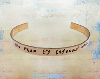 "We Rise By Lifting Others Up Hand stamped Cuff Bracelet - Mantra- Yoga Jewelry - Love Your Tribe 1/4"" brass …"