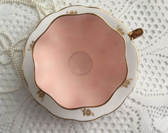 Queen Anne Fine Bone China Tea Cup and Saucer, Gold Flowers on White with Pink Interior