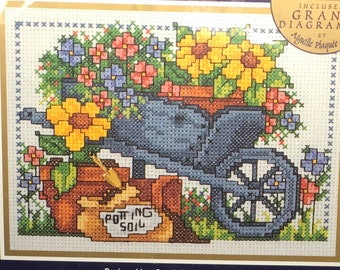 """Bucilla Counted Cross Stitch Kit 42016 Planting The Garden 5 """" x 7 """" Gardener Garden Lover Planting Sunflowers With Trowel Charm  Large Char"""