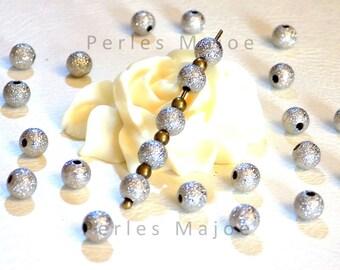 Lot de 20 perles stardust rondes en laiton couleur platine diamètre 6 mm