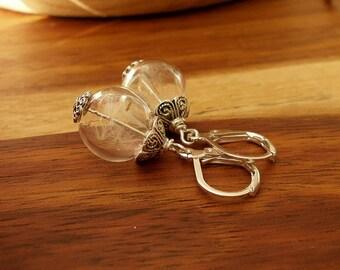 Dandelion earrings on Ohrbrisur