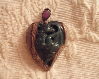 Moving sale!  50%off many items! Regular 45.00 Hand carved dragon pendant with Ruby bale
