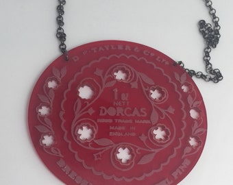 Red large Dorcas pin tin inspired acrylic necklace pendant Laser cut from acrylic . by Emily M A Parkin