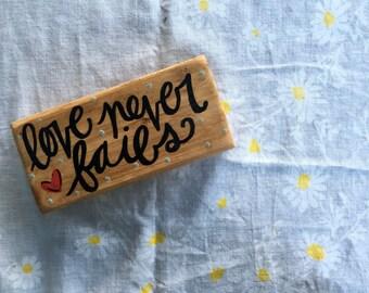 Love Never Fails // wood sign.