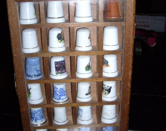 24 Collectible Thimbles in Cabinet + 12 Chistmas Thimbles