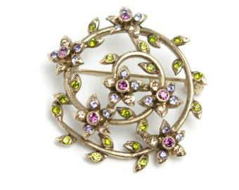Vintage 1980s Signed MONET Peridot Green, Purple and Violet Swirl Flower Rhinestone Brooch In Gold Tone Metal