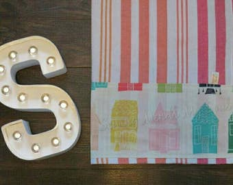Multi colored row of houses trimmed tea towel