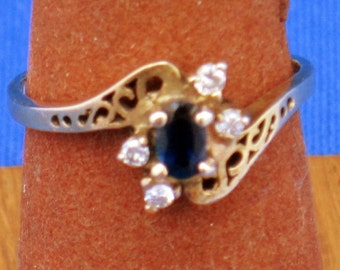 14K Gold Ring with .20 Sapphire and four diamonds