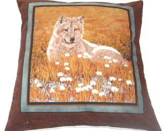 Wolf in a summer meadow cushion