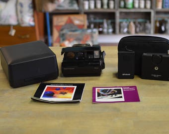 Polaroid Spectra System ONYX transparent camera with cases, manuals & Remote Control