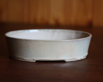 Oval bonsai pot with a cream glaze