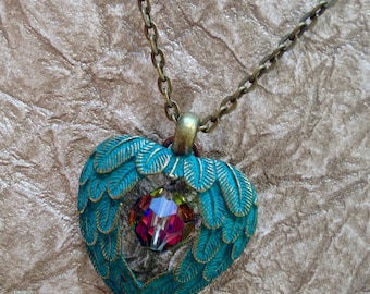 Angel Wings Surround a Beautiful Crystal -Necklace - Patina