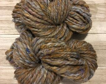 Chunky yarn in fawn, cornflower blue, and lilac