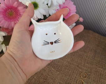 Super cute handmade white ceramic cat face ring catcher holder with 24 carat gold detail.