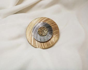 Handmade brooch from synthetic and bronze material