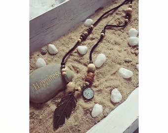 Boho leather necklace with wooden beads and bronze pendant