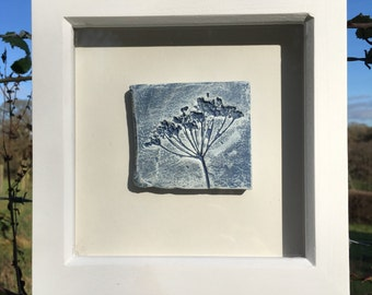 Framed original wall art, clay impression of Queen Anne's lace, blue & white in a white wooden frame.