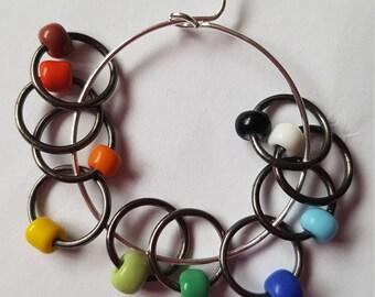 12 medium sized snag free ring style knitting stitch markers  . Rainbow