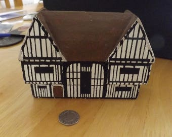 Tudor Manor House from a piece of wood. Unusual and attractive