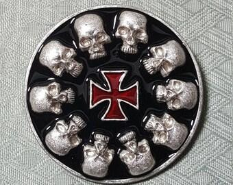 10 skulls on a round buckle