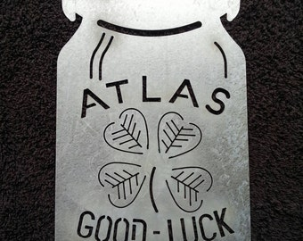 Atlas Good Luck bale lid jar galvanized steel sign