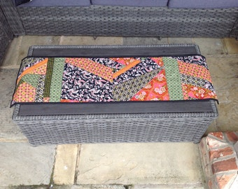Quilted table runner in colourful Indonesian batik in a crazy patchwork design