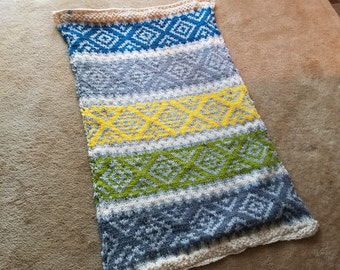 Faire Isle hand knit throw rug.  It can also be used as a wall hanging.