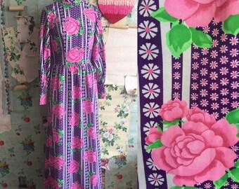 Vintage 1970s psychedelic floral maxi dress. Medium. Roses, pink, purple.