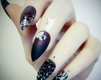 Violet / black with silver accents and Swarovski covered nail