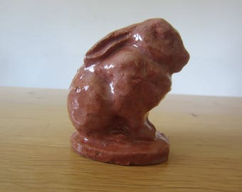 Hand-modeled rabbit made of red clay with clear glaze