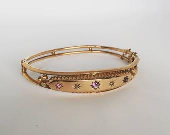 Edwardian diamond and amethyst 9ct rose gold bangle