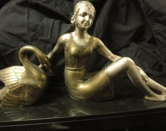 Art Deco Cast Bronze figure of a lady with a swan on black marble plinth