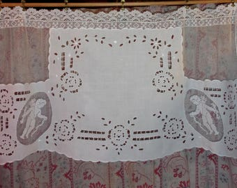 Curtain, old lace, old embroideries and cherubs