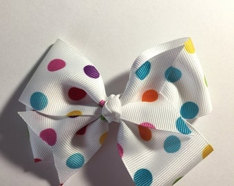 Multi colored polka dotted hair bow