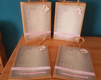 4 Gift bags with a handmade design.