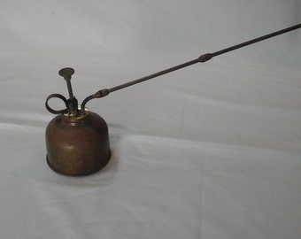Brass and copper oil can