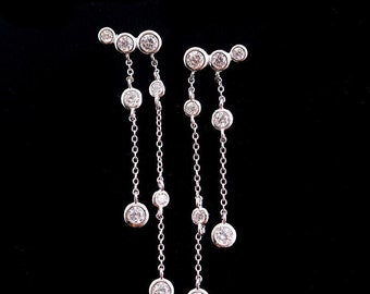 Silver long tasel drop earrings with cubic zirconia