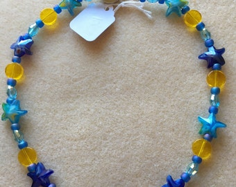 Blue and gold star necklace