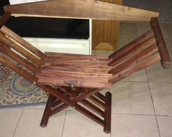 "13-15th century sytle medieval folding chair. pull the back out, lift the seat, folds flat (about 4"" thick)"