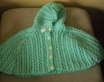 Knitted childs cape